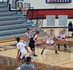 Boys Varsity Basketball beats Layton 61-58
