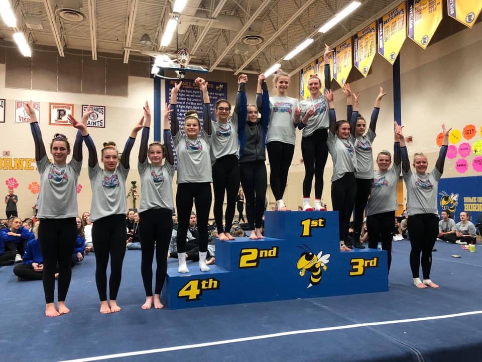 Gymnastics Team wins Tropical Twist with Highest Score of the Sesason