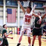 Boys Basketball advances to Quarterfinals