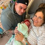 Coach James Holan and wife Ashlee welcome a new Cavalier