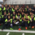 Soccer team takes Region XI title.