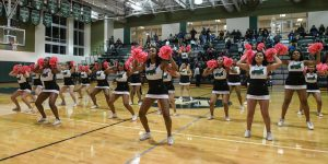 Put That Ball In the Hoop, Hoop! Varsity Cheer Keeps Us Hyped!