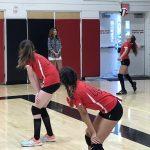 Three volleyball players.
