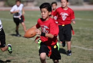Football player running with ball.