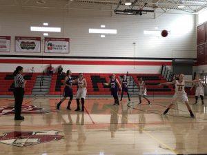Basketball player passing ball.