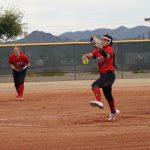 Softball player throwing ball.