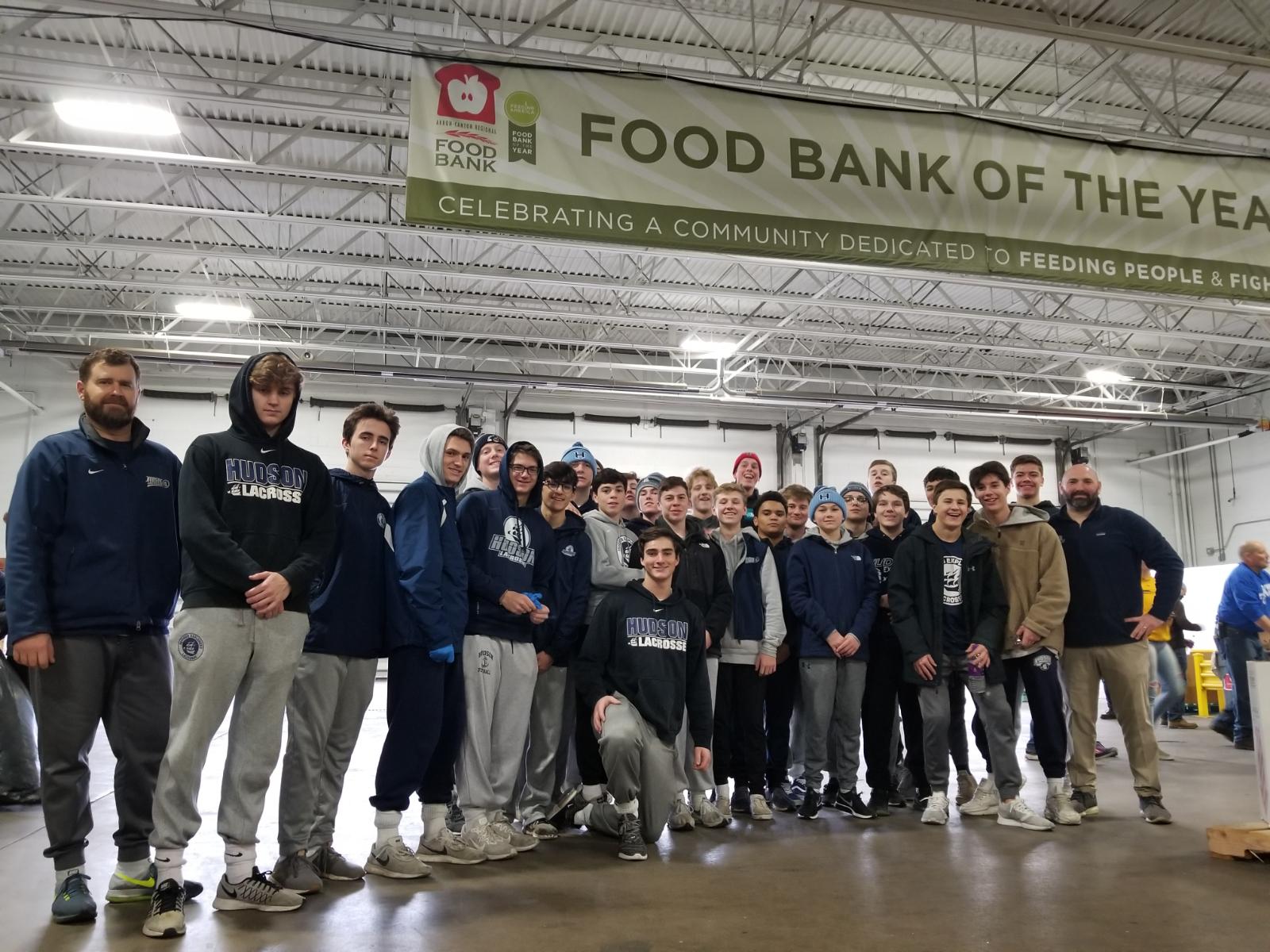 Boys Lacrosse Volunteers at Food Bank
