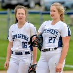 Softball drops league game in extras
