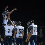 Warriors Clinch Share of League Championship; Beat Napoleon 32-7