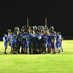Freshman Football Huddle