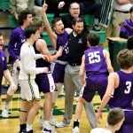Pandemonium on the Bulldog bench after Jared Wilson scores on a rebound with 1.4 seconds left in the game to give Swanton a 62-60 Sectional victory over the Woodmore Wildcats.