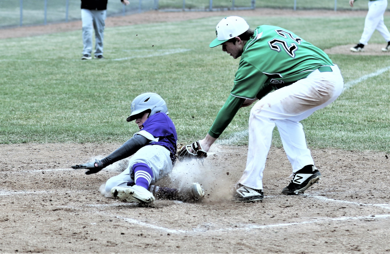 Devon Crouse scores Swanton's third run on a wild pitch and the Bulldogs went on to a 12-2 road victory over the Delta Panthers.