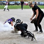 Kylie Ulch just beats the tag at the plate, scoring on a passed ball during a seven-run fourth inning as the Lady Bulldogs beat the Liberty Center Tigers 8-6 in a Sectional Semi-Final game in Swanton.