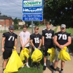 OHS Football Takes Care of their Adopted Road