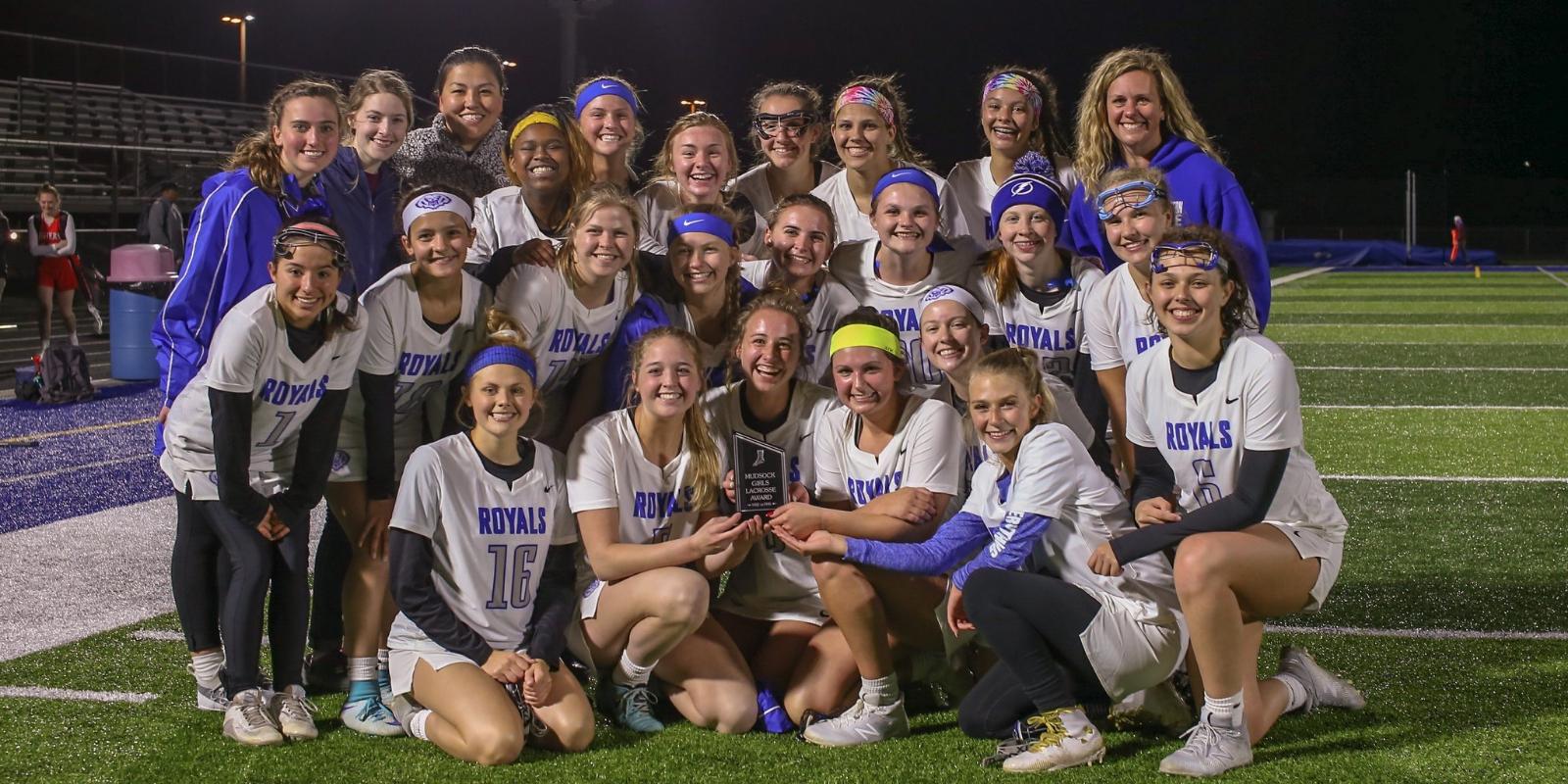 Girls Varsity Lacrosse Keeps Mudsock Trophy