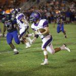 Varsity Football runs away with 58-6 win in opener