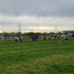 Boys middle school soccer team plays agiasnt Lincoln Prep on a soccer field in front of the goal