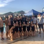 Scottsadle prep coed swim team posing by the pool in uniform after win
