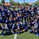 Scottsdale prep middle school football team in navy uniforms on football field