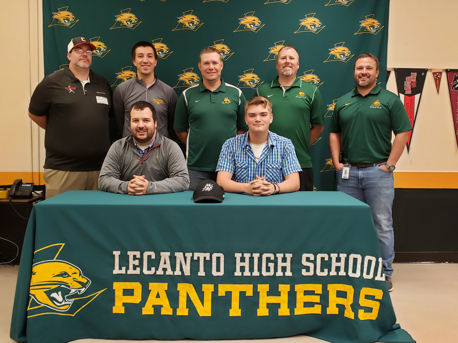 Brace signs with Bryant-Stratton