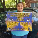 CCISD Senior taking picture with yard sign.