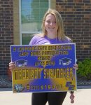 CCISD Senior taking picture with yard sign