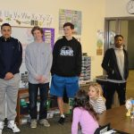 Boys Basketball Goes to GR Christian Elementary School to Read to Students