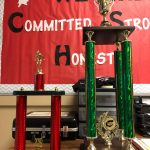 Swimming and Wrestling win their Tournaments