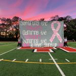 Cheerleaders honor Breast Cancer Awareness Night