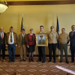 West High accepts portrait of Jose Valdez who received congressional medal of honor.