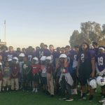 Pirates pass on some pointers to the Savant Prep Academy Flag Football team.