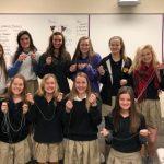 Cheerleaders make Rosaries for men & women in the Military