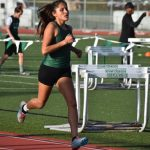 Track shines in Long Beach; splits with Mission Hills