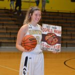 Junior Jewel McCormick scores her 1000th point