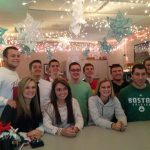 Green Athletic Student Assistants Prepare for Christmas