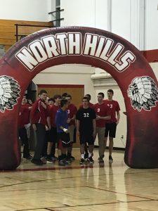 boys volleyball under arch