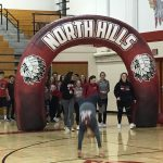 Track team under arch with Ang doing a handspring