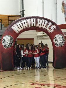 girls lacrosse under arch