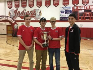 Boys' tennis players pose with academic cup