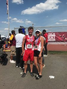 Tom and Amberly with medals