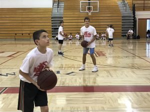 Youth Camp shooting basketball