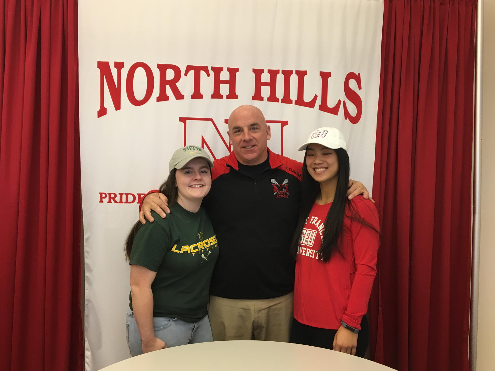 NH Girls' Lacrosse Players sign National Letter of Intent!