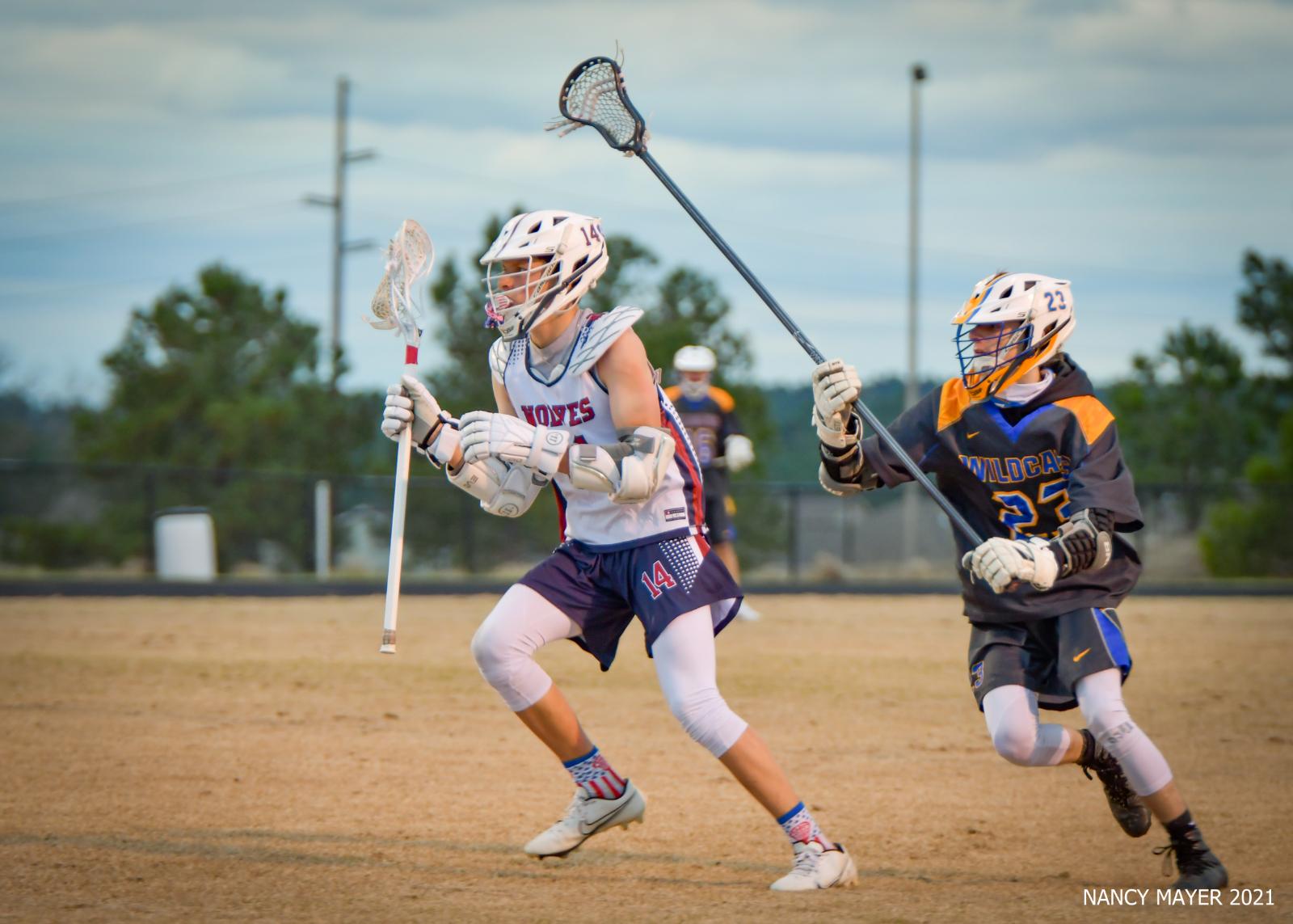 Photos – Boys Varsity LAX vs LHS 3/19/2021