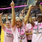 Photo of Valley players holding 2019 state girls' basketball trophy