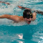 Harrell and Klein Earn Victories at District Meet