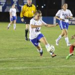 Lady Wildcats open district play with victory
