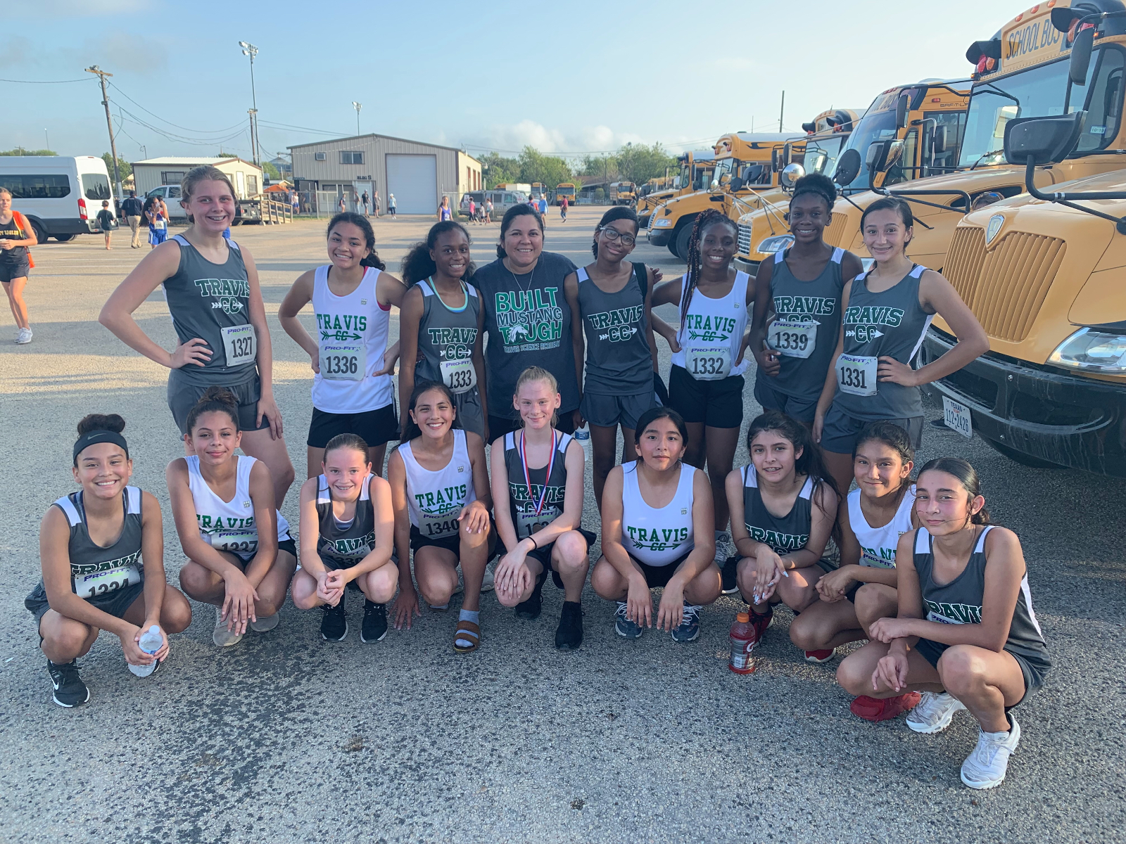 Travis girls cross country takes fourth at the Rogers Invitational