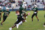 Travis 7th grade football splits with Tennyson