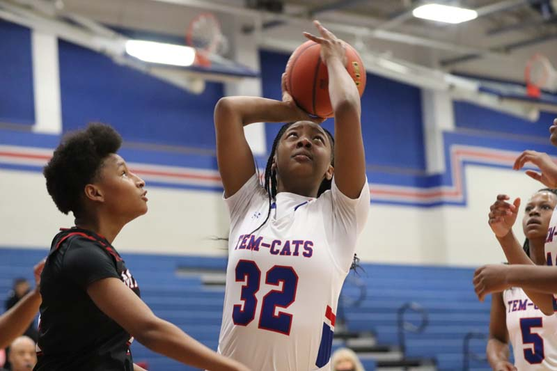Hall leads Tem-Cats past Manor 68-38