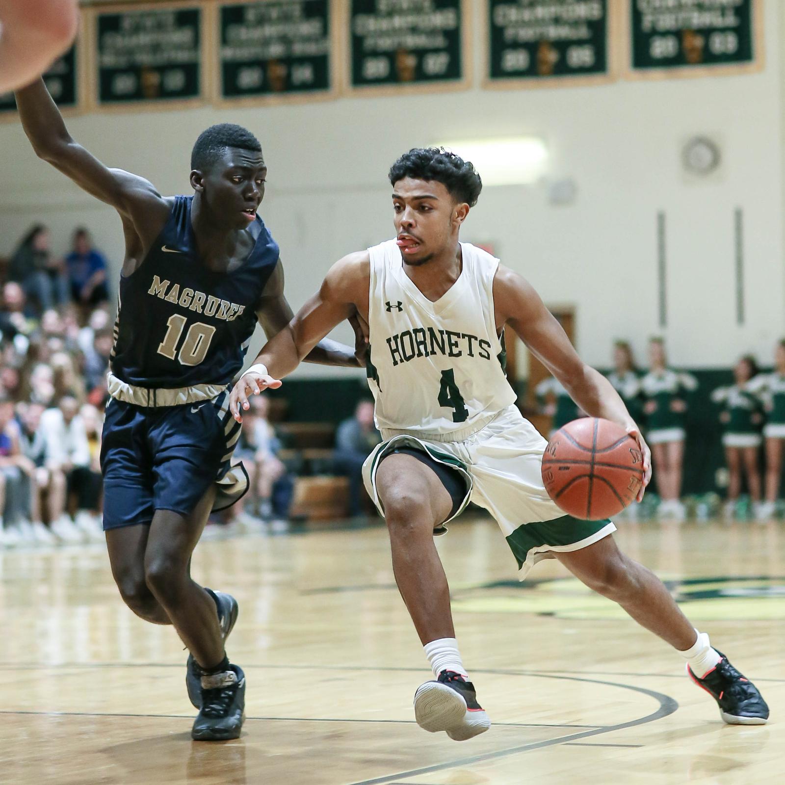 Big Win Pushes Boys Basketball into Regional Finals
